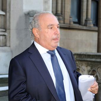 Businessman Sir Philip Green leaves the High Court after giving evidence in the case brought by Michelle Young against her estranged husband, Scot Young