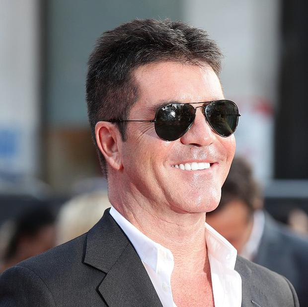 Simon Cowell said the secret is to be useless at school and get lucky