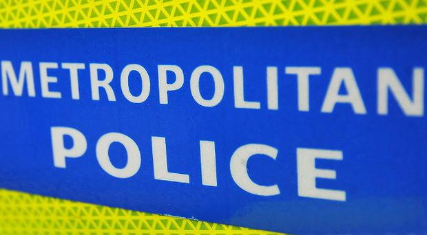 Police are investigating the discovery of a body in a well in south London