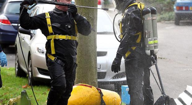 Seven men were arrested after a body was discovered in a well in Warlingham, Surrey