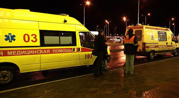 Ambulances in front of the airport building in Kazan where a Russian passenger airliner crashed