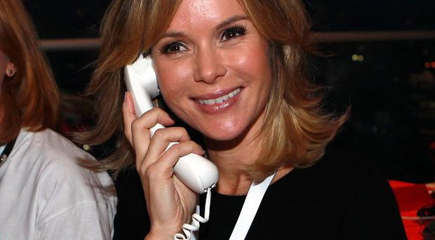 Amanda Holden answers the phones at the Philippines Disaster Emergency Committee appeal at the BT Tower, London.