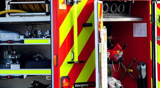 Firefighters rescued three people, including two young girls, from a blaze at a flat in Linlithgow