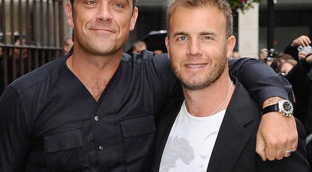Take That stars Gary Barlow and Robbie Williams are battling it out in the charts