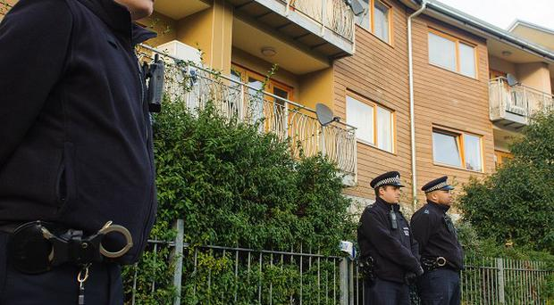 Police carried out house-to-house inquiries over the weekend in and around Peckford Place, Brixton, where the three women were found