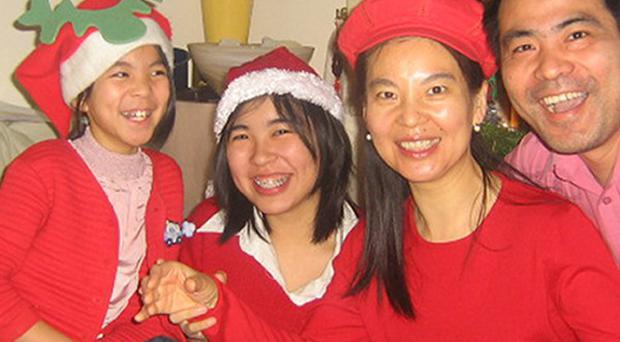 Jifeng Ding with his wife Helen and daughters Xing and Alice, who were found dead at their home in Northamptonshire
