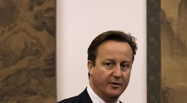David Cameron at the Victoria & Albert Museum to bone up on Chinese culture ahead of his visit.