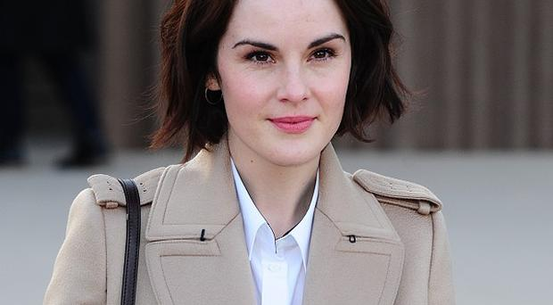 Downton Abbey star Michelle Dockery has told of 'traumatic conditions' at a Syrian refugee camp in Jordan