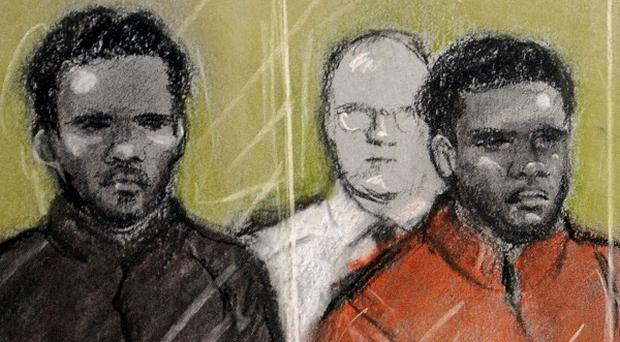The two men accused of the murder of Fusilier Lee Rigby, Michael Adebolajo (left) and Michael Adebowale (right) during their trial at the Old Bailey in central London.