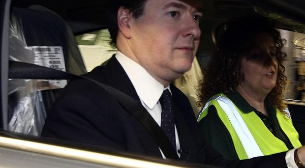 George Osborne has boosted motorists by scrapping a planned fuel tax rise.