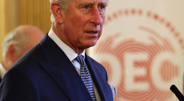 The Prince of Wales speaks to guests at a reception to mark the 50th anniversary of the Disasters Emergency Council held at Lancaster House in central London.