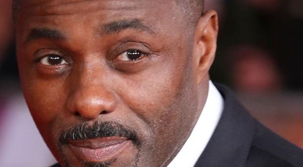 Idris Elba attends the premiere of Mandela: Long Walk to Freedom at the Odeon Leicester Square, London