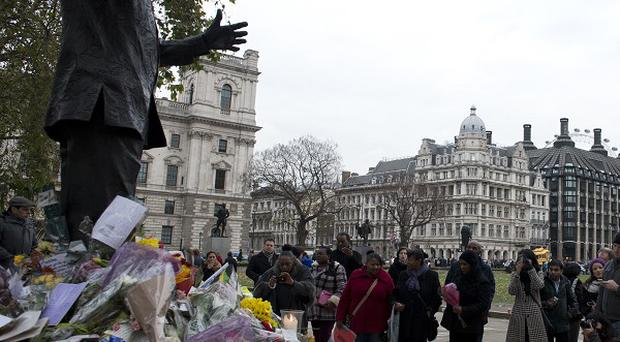 Tributes left at the Nelson Mandela statue in Parliament Square