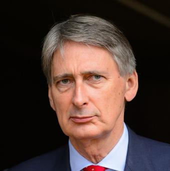 Defence Secretary Philip Hammond has indicated he will not accept extra cash as part of a pay rise for MPs