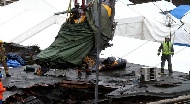 The wreckage of the police Eurocopter being lifted from the Clutha bar in Glasgow