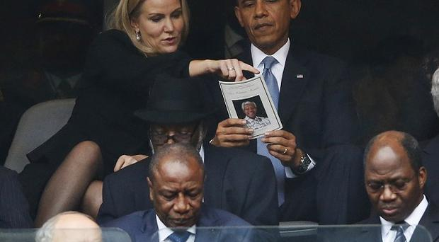 President Barack Obama talks with Danish prime minister Helle Thorning-Schmidt during the memorial service for former South African president Nelson Mandela (AP)