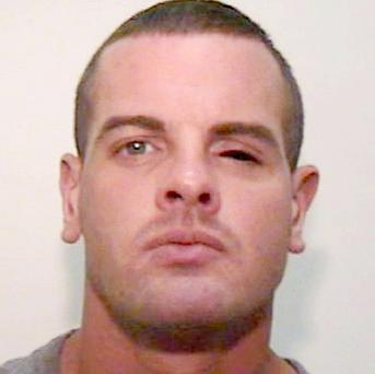 Police-killer Dale Cregan - three people are on trial charged with assisting him while he was on the run.