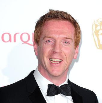 Homeland actor Damian Lewis has apologised to Lord Of The Rings star Sir Ian McKellen