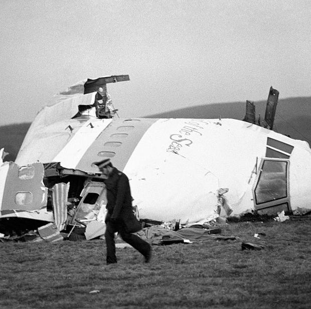 The wrecked nose section of the Pan-Am Boeing 747 lies in a field at Lockerbie