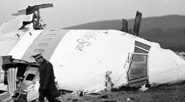 The nose section of the crashed Pan Am jumbo jet in fields near Lockerbie.