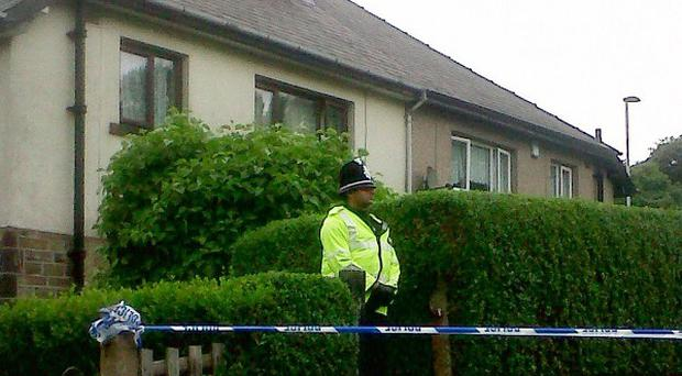 A police officer outside Prospect Mount, Shipley, where Louisa Denby was found dead.