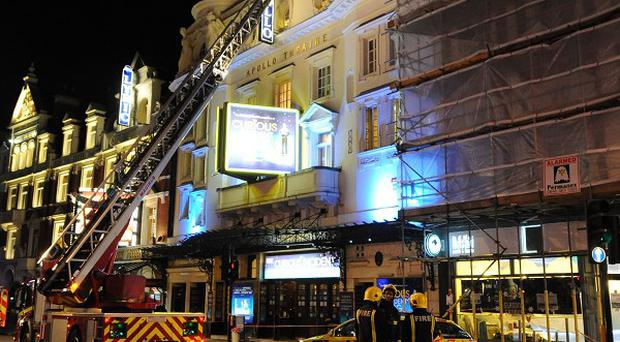 Emergency services attend the scene at the Apollo Theatre in Shaftesbury Avenue, central London.