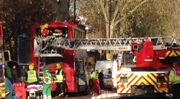 Police, ambulance and fire crews rescue passengers from the back of a bus that crashed in Kennington Road, south London in which a number of people have been injured.