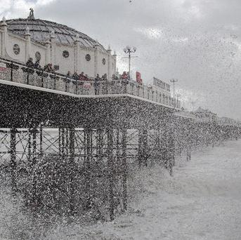 A search is under way for a woman swept out to sea near the Palace Pier in Brighton.