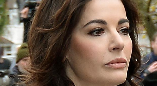 Police say they will review Nigella Lawson's court admission that she used cocaine.