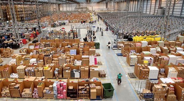 An Amazon warehouse in Cambridgeshire - the online retail firm is bringing forward its 'Boxing Day' sales to Christmas Day