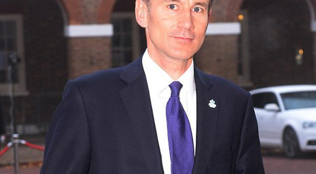 Health secretary Jeremy Hunt says displaying the names of a doctor and nurse above the beds of hospital patients will help rebuild trust in the NHS.
