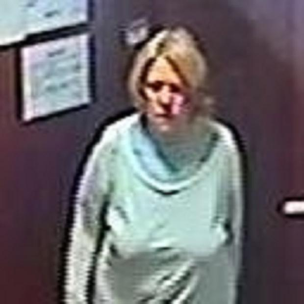 Police are appealing to the public to try and identify a woman who was captured on CCTV stealing a Christmas tree from a care home in Camberwell, London.