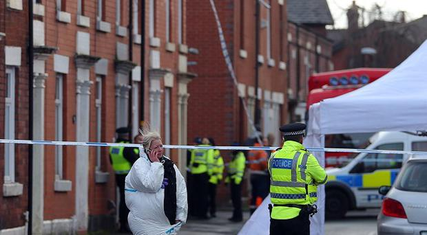 Police attend the scene in Chorley after the body of a man was found.