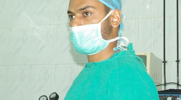 Dr Abbas Khan in an operating theatre.
