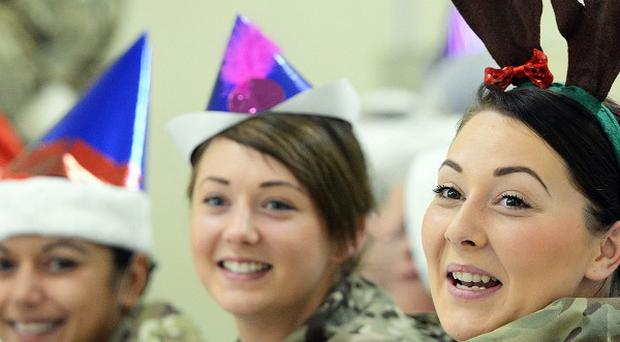 British troops celebrate Christmas lunch in Camp Bastion, Afghanistan.