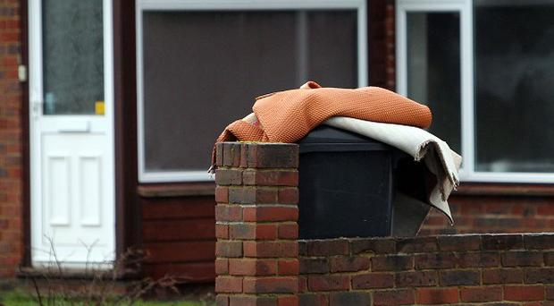 Carpets thrown out after a house was flooded in Leatherhead in Surrey when floods hit the area.