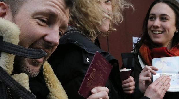 Phil Ball, left, and Alexandra Harris, right, are among five Britons detained in Russia who are returning home to the UK