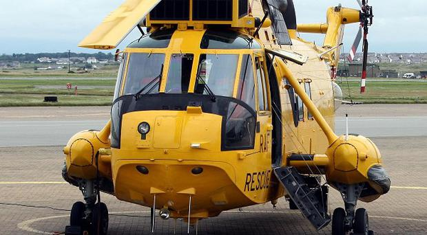 Two RAF helicopters winched four people to safety after suffering from smoke inhalation when a fire broke out on a North Sea ferry