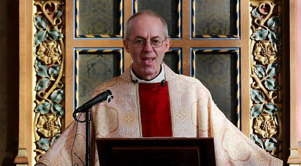 The Archbishop of Canterbury, Justin Welby, says the Church of England is looking into how it can dispose of shares in Wonga
