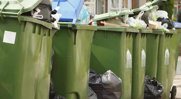 Communities Secretary Eric Pickles attacked councils trying to end weekly rubbish collections, issuing a 'bin bible' exposing claims made to justify cuts