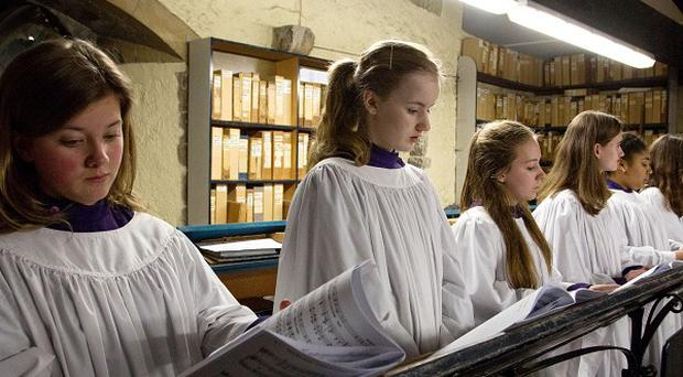 Members of the Canterbury Cathedral Girls Choir rehearse for the first time in the Singing Room of Canterbury Cathedral