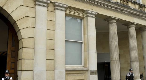 Three lapdancers and their manager have denied kidnap charges at Bristol Crown Court