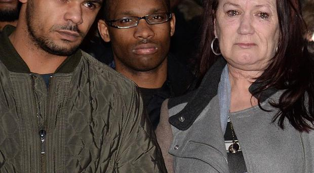 Mark Duggan's mother, Pam Duggan, and her son Marlon Duggan outside the Royal Courts of Justice