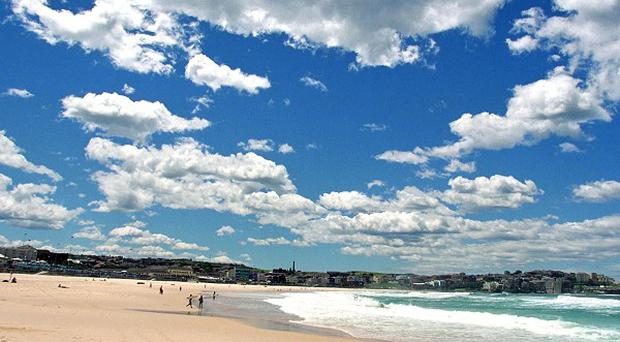 Andrew Priestley, from Leicestershire, died in hospital after getting into difficulty at Burrill Beach in Australia
