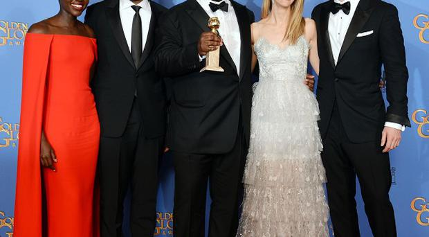 From left, Lupita Nyong'o, Chiwetel Ejiofor, Steve McQueen, Sarah Paulson and Michael Fassbender with the award for best motion picture - drama (AP)