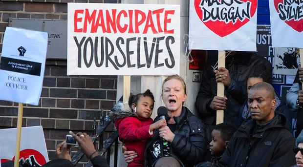 Carol Duggan, aunt of Mark Duggan, speaks at a vigil in his memory outside Tottenham police station in north London