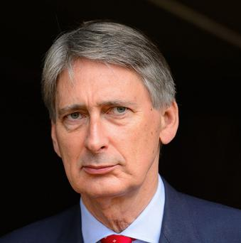 Defence Secretary Philip Hammond is being urged to spend nearly £50m to replace a botched MoD computer system