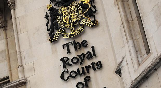A convicted Colombian has won damages at the High Court