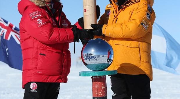 Prince Harry, left, and Heath Jamieson of Team Commonwealth reach the South Pole as part of the Walking With The Wounded charity trek (Walking With The Wounded/PA)