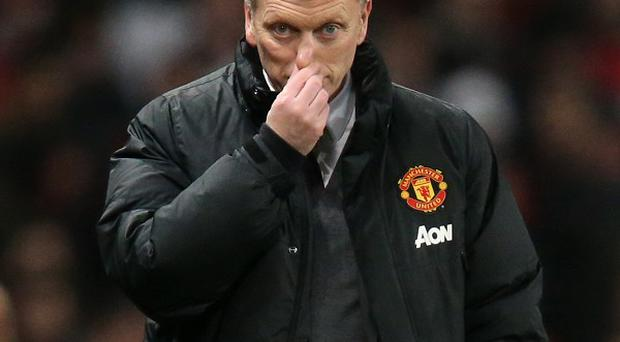 A dejected David Moyes as his Manchester United club drop out of the top three of Europe's top-earning clubs for first time.
